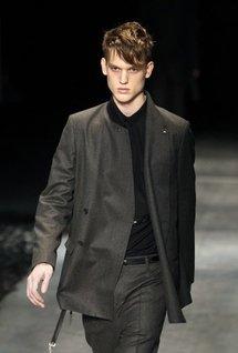 A model presents a creation by designer Kris Van Assche for Dior