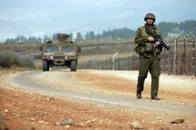 An Israeli soldier patrols the border with Lebanon