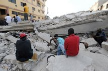 People on the rubble of their home in Port-au-Prince