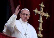 Pope Francis defends stance on Rohingya on return to Rome
