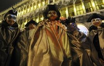Revellers don masks for Venice Carnival