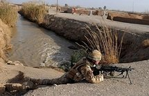 A British soldier takes his position during a patrol in Qari Saheb village in the Helmand province on the third day of a joint operation Mushtarak. (AFP/Massoud Hossaini)