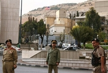 Syrian police stand guard outside the US embassy in Damascus (Louai Beshara/AFP)