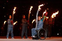 Torch bearer Marni Abbott-Peter waves during the opening ceremony of the Paralympics in Vancouver