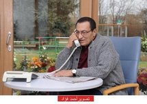 A picture released by the Egyptian Ministry of Information shows Egyptian President Hosni Mubarak making a phone call at the University of Heidelberg hospital. (AFP/HO)