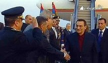 An image grab taken from footage broadcast by the Egyptian state television shows Egyptian president Hosni Mubarak (second right) being greeted by officials upon his arrival at Sharm el-Sheikh.  (AFP/Egyptian TV)