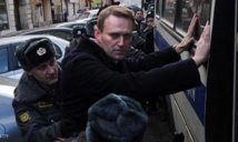 Putin foe Navalny detained, office raided amid protests across Russia