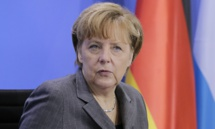 Merkel expects tough talks as coalition negotiations approach end