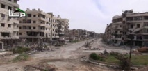 Hundreds of Syrian rebels, civilians leave besieged town of Harasta