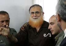 Mohammed Abu Teir arrives in the dock at an Israeli military court in Ofer in 2006.
