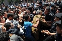 A protester scuffles with police during a demonstration near the parliament building in downtown Cairo on 3rd May, to demand fair elections as well as constitutional reforms and an end to emergency laws.