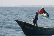 A Palestinian boy flashes the V-sign for victory as hundreds of Palestinians waited on fishing boats at the port of Gaza City to greet the 'Freedom Flotilla'.