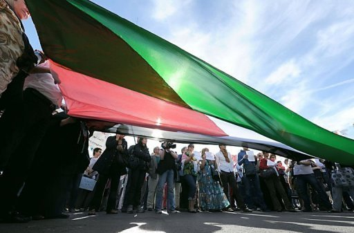 People hold a Palestinian flag during a demonstration in Marseille, southern France.