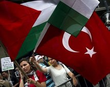 Young women wave the national flags of Turkey and Palestine during a rally in New York, on 1st June.