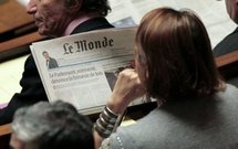An MP reads Le Monde at the National Assembly in Paris.