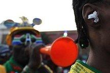 In Johannesburg, a fan wears paper ear plugs to block out the sound of a vuvuzela.