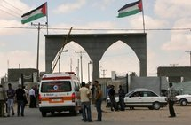 Palestinians and an ambulance wait to cross the Rafah border crossing with Egypt in the southern Gaza strip.