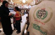 Palestinian women and children attend an event organized by Turkish Muslim charity IHH.