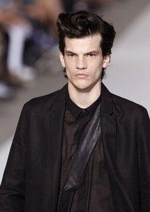 A model presents a creation by Belgian designer Kris Van Assche.