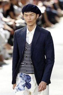 A model presents a creation for Kenzo