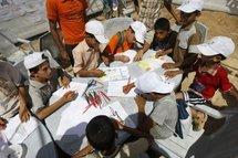 Gunmen set fire to second UN summer camp in Gaza
