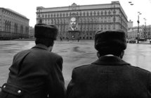 Soviet police officers stand in front of the KGB building in Moscow in 1990.