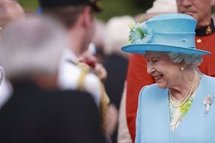 Britain's Queen Elizabeth II greets well-wishers during a garden reception at Rideau Hall Ottawa, Canada, on 30th June.