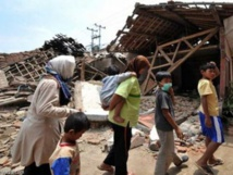 At least 384 dead, 29 missing after Indonesian quakes and tsunami