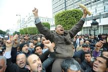 Tunisia approves amnesty, declares mourning