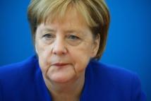 Merkel and Jewish head warn of rising anti-Semitism at pogrom event