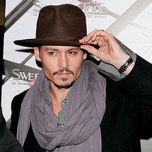 "Depp leads ""Rango"" to top of box office"