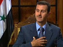 Assad scoffs at Western calls to quit, UN visits