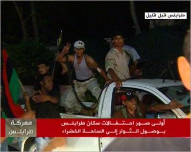 Tripoli erupts in joy as Kadhafi compound falls