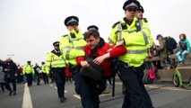 Police detain 122 climate change protesters over London blockades