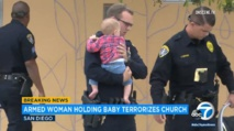 Woman waving handgun, carrying baby, threatens to blow up US church