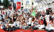 Climate activists occupy red carpet on final day of Venice film fest