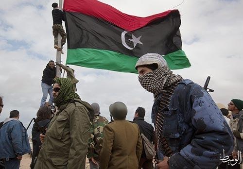 Libya's NTC adopts election law, drops women quota