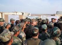 Syrian president attacks 'thief' Erdogan during troops visit