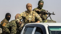 Syrian government forces retake control of key road from Kurds