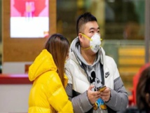 Coronavirus infections top 20,000 as Hong Kong reports first death