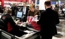 Amid crisis, Germany's Merkel goes shopping for toilet paper and wine