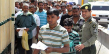 India grapples with exodus of migrant workers as virus cases near 900