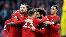 Liverpool's players and coaches show anti-racism stance