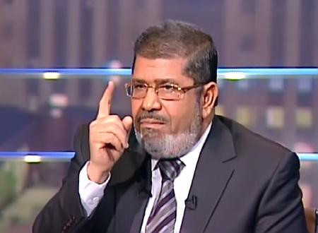 Egypt's Morsi promises democracy as protests rage