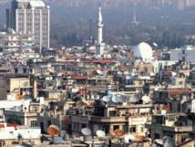 Thousands of Palestinians return to Damascus refugee camp