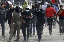 Egypt arrests  12 'Black Bloc' members at presidency