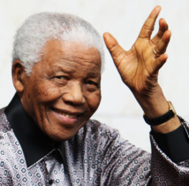 Mandela family seeks criminal charges in grave rift