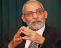 Egypt orders Brotherhood chief held, Morsi in 'safe place'