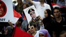 Egypt army chief urges rallies, Islamists warn of war