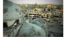 Syria army retakes key Homs rebel district